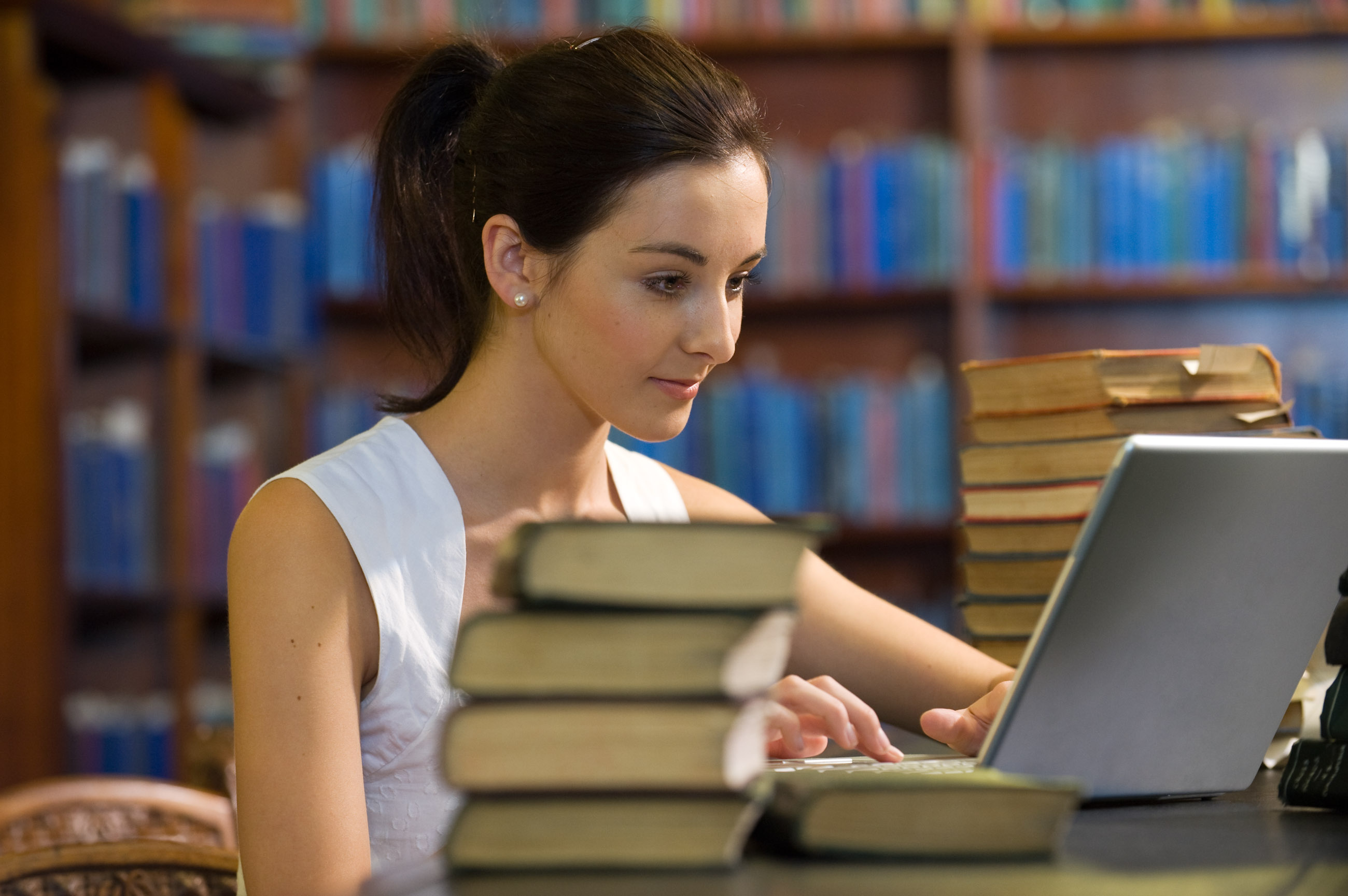 College Student Studying in Library --- Image by © Peter M. Fisher/Corbis